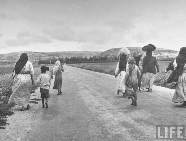 Women and children refugees evacuating the village of Zenin