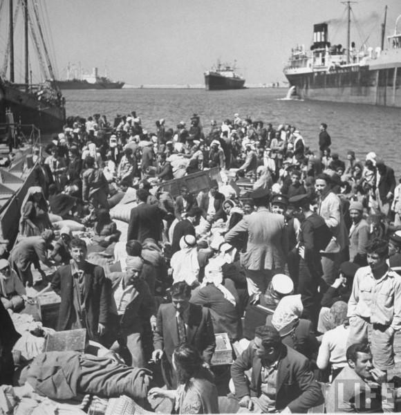 Arab refugees in Haifa waiting to be ferried to an Arab city