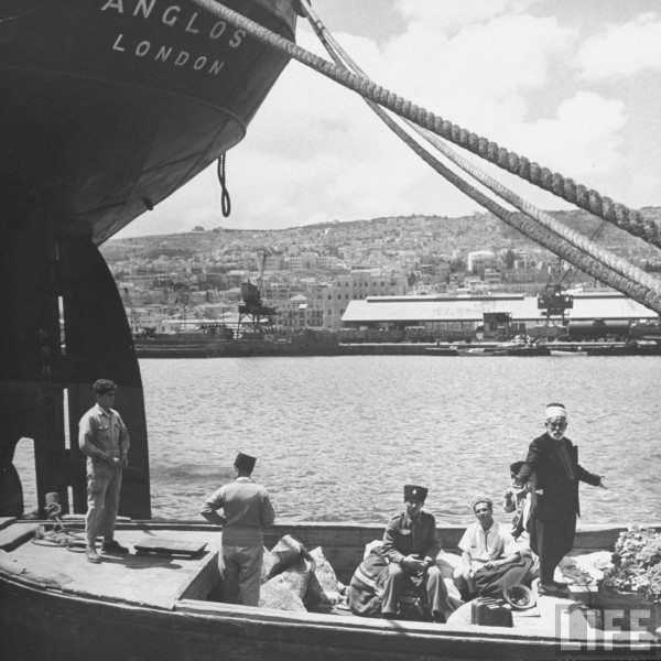 A barge bringing Arab refugees to the dock in Haifa