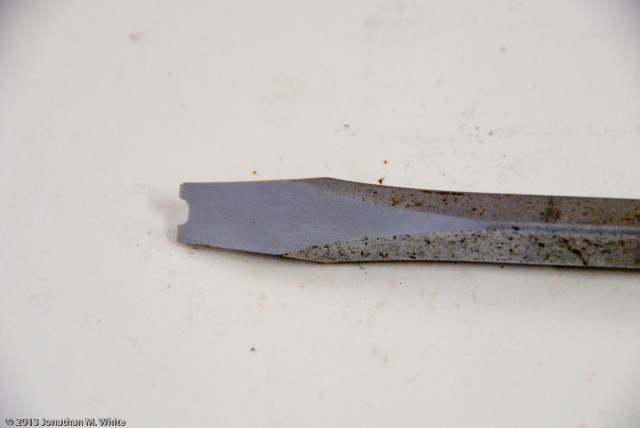 A flat head screwdriver is easy to modify to use it as a split nut driver.
