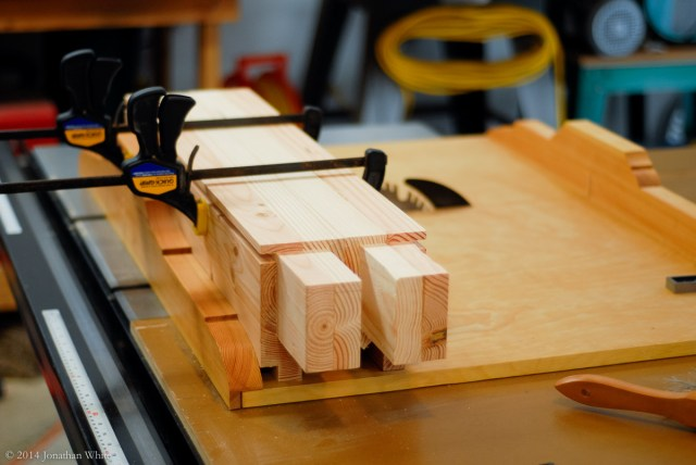 Clamping the stretchers together to ensure they stay flush.