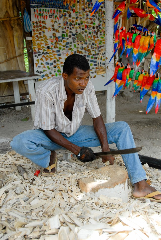Making wooden parrots with just a machete.