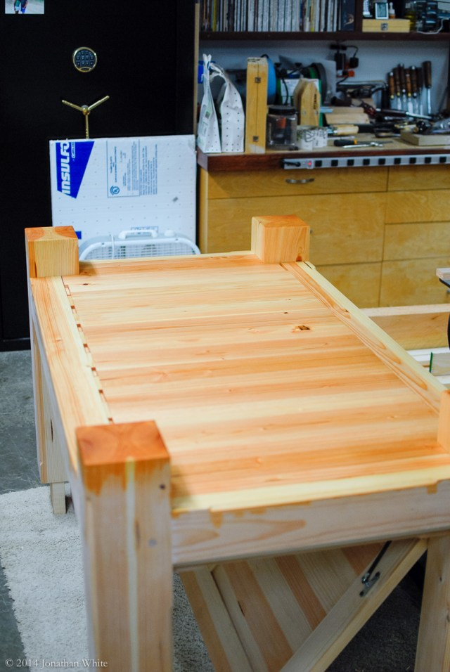 I put on three coats of Watch Danish Oil on the underside of the workbench base.