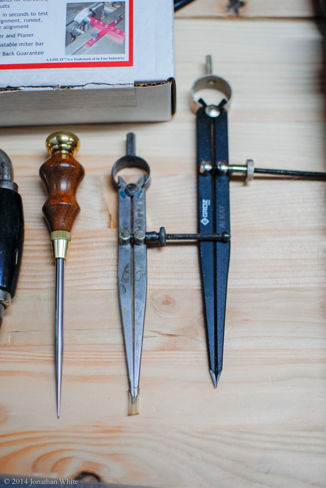 An awl, six inch dividers, and eight inch dividers.