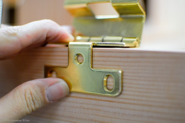 I held the hinge in place with its barrel in the corresponding mortise.
