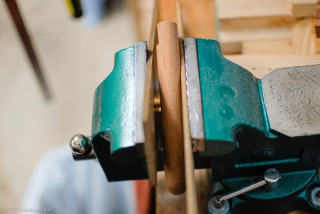 I used my bench vise to press in the bullet catch.
