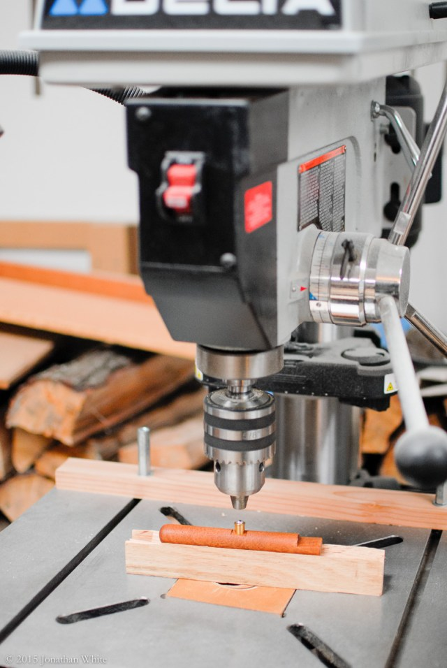 Using the drill press to install the bullet catches.