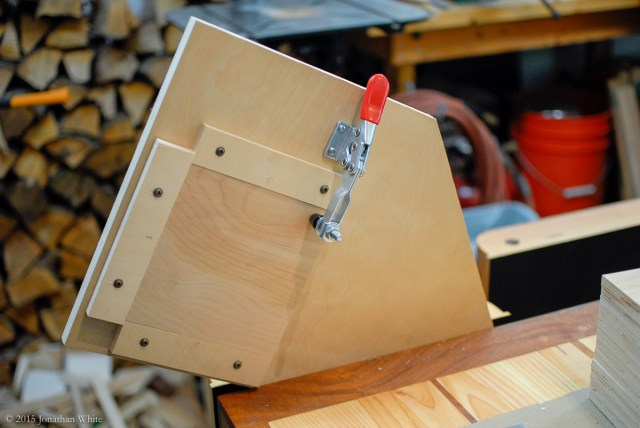 Installing one of the 6 11/16-inch blanks in the jig.