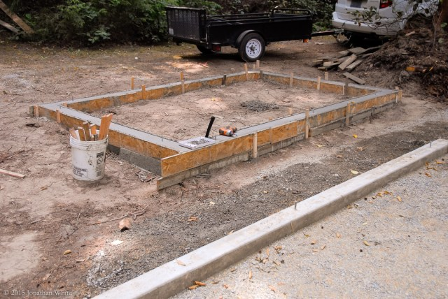 Since I still had the forms, I decided to pour a foundation for a firewood storage shed.