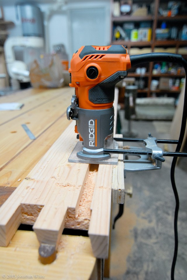 """Once the pins were cut, I routed a groove to house the ¾"""" plywood base."""