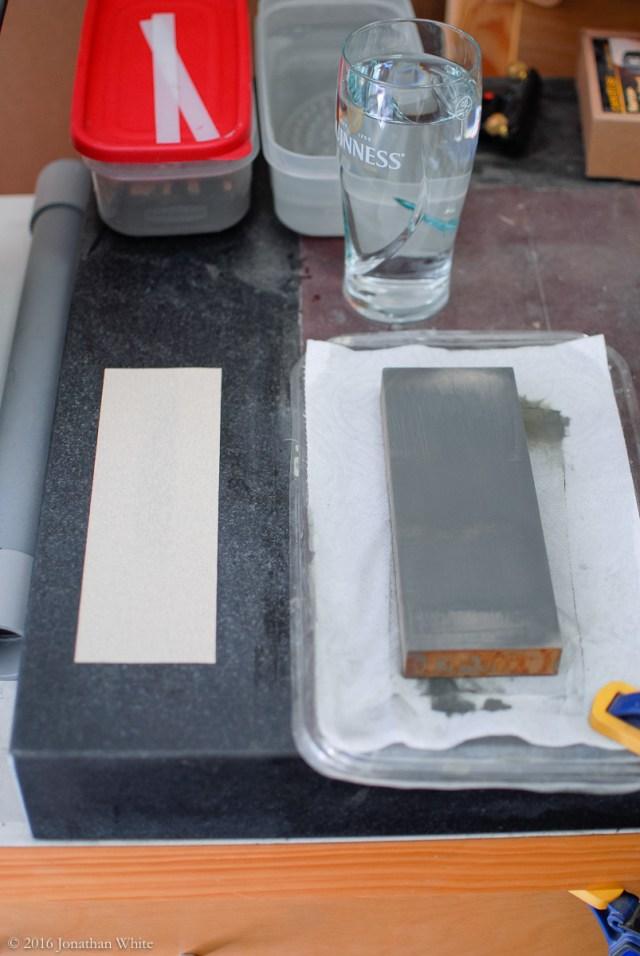 Some 100 grit self adhesive paper on my granite slab.
