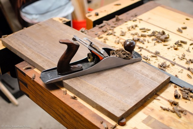 Traversing across with the jack plane to remove the cup.