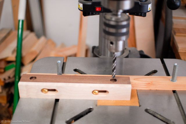 The right through hole was drilled with a 5/16-inch bit. This will intentionally create a little slop and allow for adjustment of the fence.