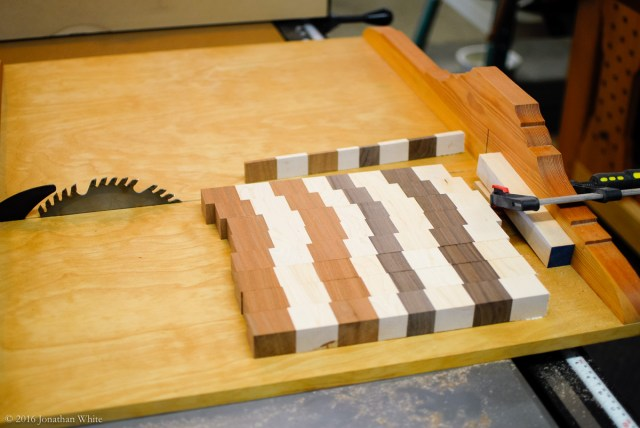 Using a stop block on my cross-cut sled, I cut the glued up board into strips about 1 ½ inches thick.