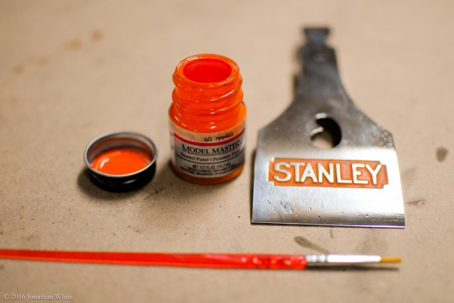 Model paint used to freshen up the orange in the lever cap.