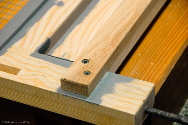 The oak runner was glued and clamped to the doug fir drawer guide prior to installation.