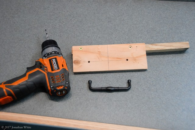 I made a quick jig for installing drawer pulls.