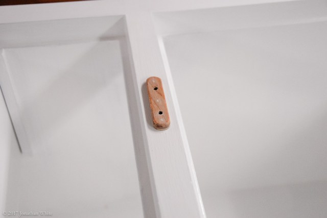 A wooden spacer on which to mount the catch.