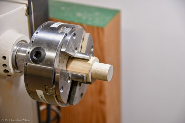 Using an off-cut to make a jam chuck for the brass fitting.