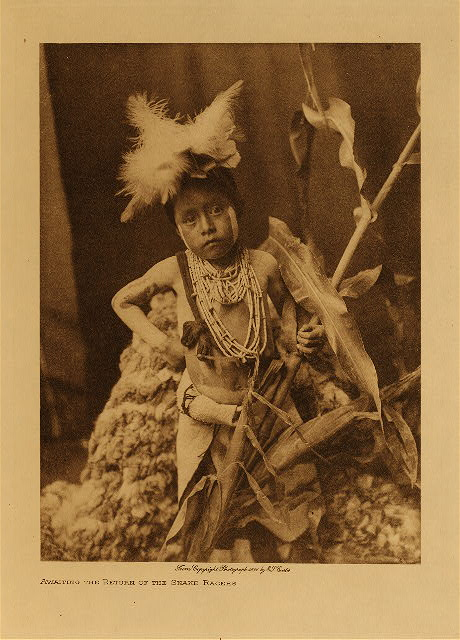 Awaiting the return of the snake racers by Edward S. Curtis. 1921.