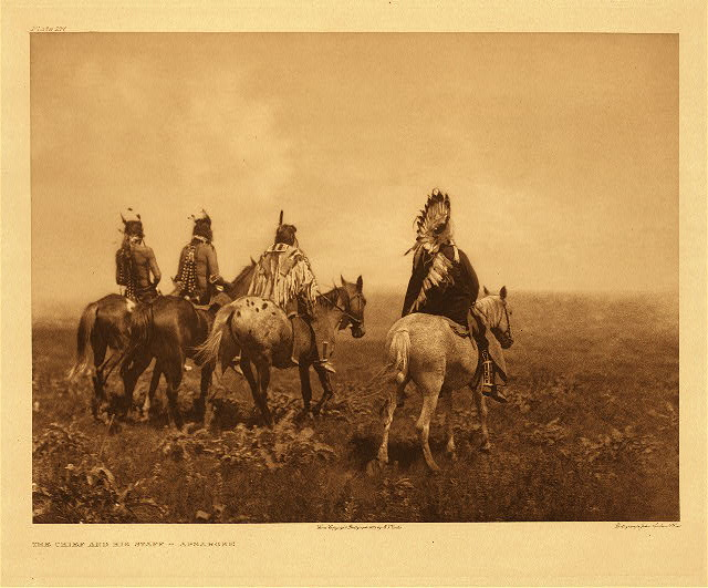 Chief and his staff - Apsaroke by Edward S. Curtis. 1905.