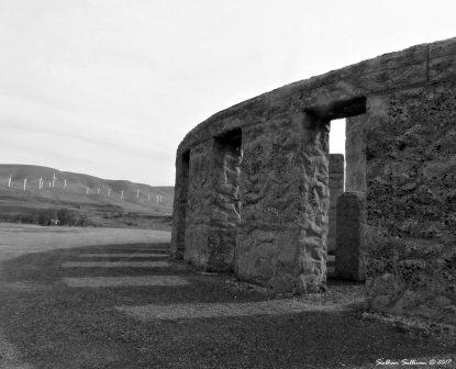 Stonehenge Memorial near Maryhill,WA with wind turbines