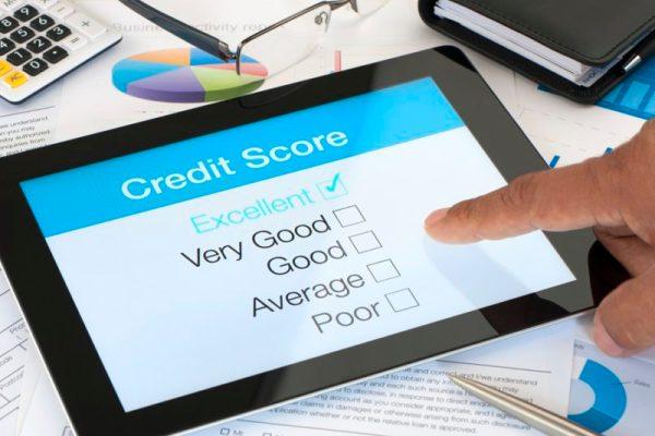 Credit score on a digital tablet with desk background