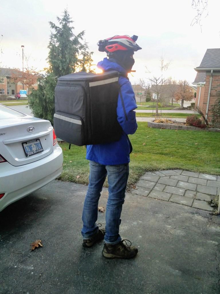 Ben wearing a big UberEATS backpack that looks like a giant box