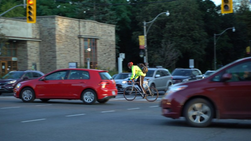cyclist wearing reflective clothing in toronto traffic