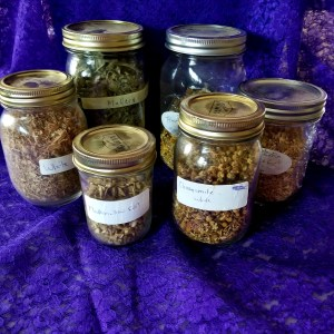 Six jars filled with herbs