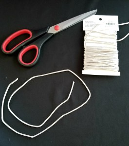 Lunar Knot Magick- supplies: Scissors, a package of cording and a cut piece of silver cord.