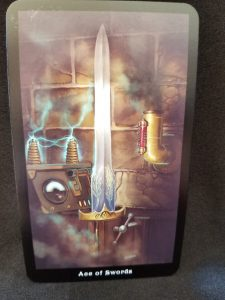 Ace of Swords - Glowing sword in front of two coils sending out an electrical charge.