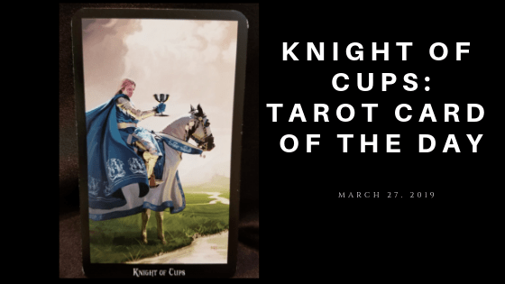 Knight of Cups - armor clad man atop a white horse holding a gold chalice in his hand