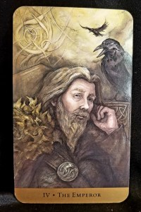The Emperor: Man sitting in contemplation flanked by two ravens