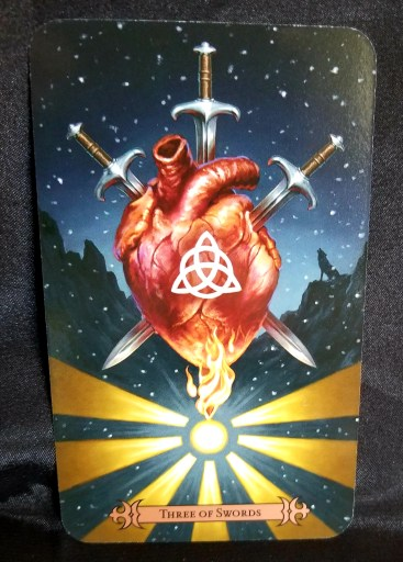 Three of Swords - a stylized human heart with three swords thrust through it