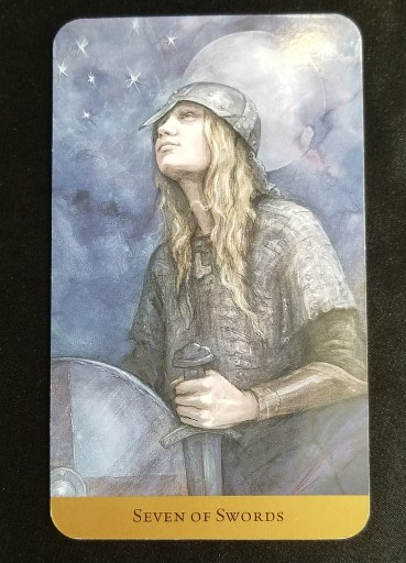 Seven of Swords Tarot Card:  A young man dressed in chainmail, wearing a helm, staring up at the stars