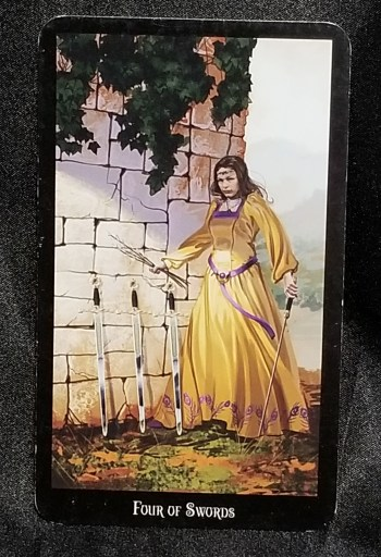 Four of Swords - Tarot Card:  A stern looking woman holding a sword and standing next to three more.