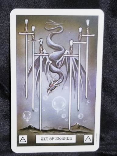 Six of Swords - Tarot Card - a grey dragon hovering between six silver swords, bubble beneath him