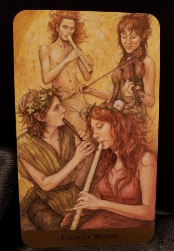 Four of Wands - Tarot Card:  Four elfin individuals playing various instruments.