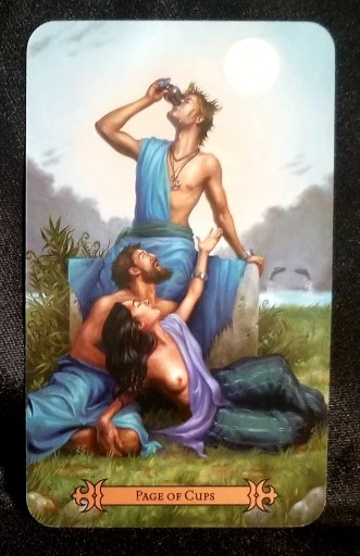 Page of Cups - Tarot Card:  A toga wrapped man sitting on a rock drinking from a cup. A man and woman are seated at his fit, the woman raising her hand towards him.