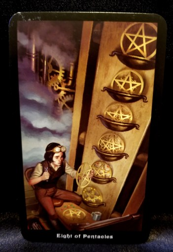 Eight of Pentacles - Tarot Card:  A young person dressed in steampunk attire working diligently at creating pentacle disks.