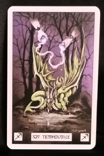 Temperance - Tarot Card:  A green dragon looking into a pond.  Two hands move out from between the trees, pouring liquid onto the dragon.