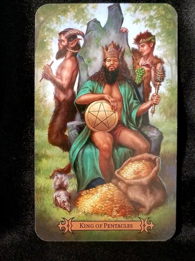 King of Pentacles - Tarot Card:  A bearded king wearing a green robe and crown sits upon a stone throne.  A Satyr and a Pan flak the throne.