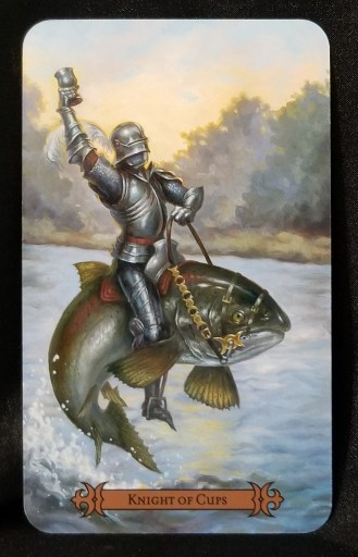 Knight of Cups - Tarot Card: A knight in armor riding a liveried, thrashing, trout. The knight is holding a cup in one gauntleted hand.