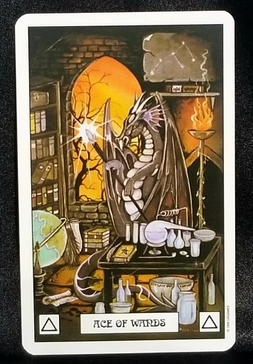 Ace of Wands - A Dragon working in an alchemical lab