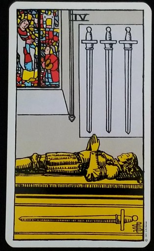 Four of Swords-Tarot: A man lying in a crypt, three swords haning over his head and one emblazoned upon the pyre