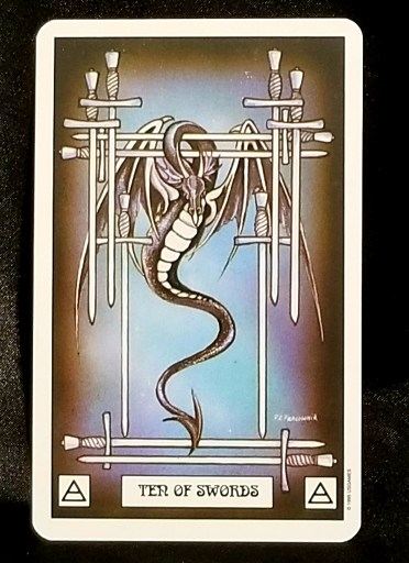 Ten of Swords-Tarot: A large silver dragon surrounded by ten swords