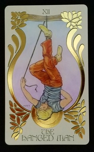 The Hanged Man- A man hanging upside down by one foot.