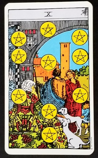 Ten of Pentacles- A man and woman stand under an archway.  An older man looks on.