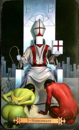 Hierophant- A religious figure - face obscured - sits on a stone throne.  A man and a woman kneel at his feet.